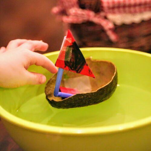 hand pushing avocado boat