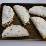 assembled quesadillas on sheet
