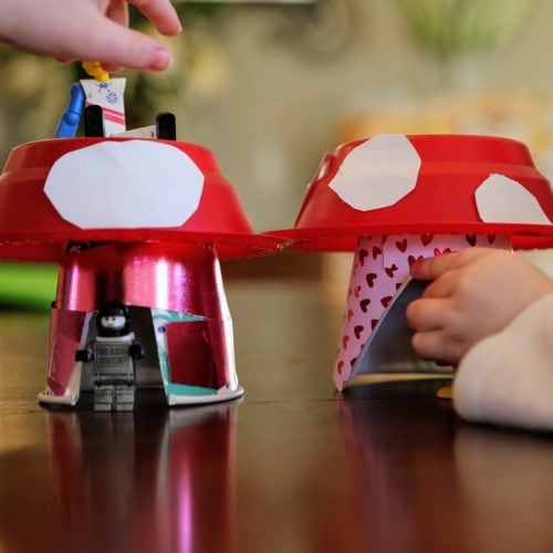 kids playing with their mushroom house craft