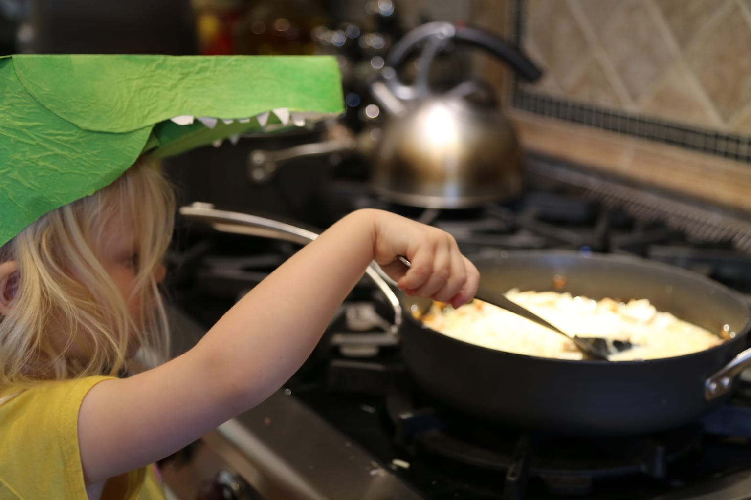 Child stirring sauce for Homestyle Chicken and Pasta