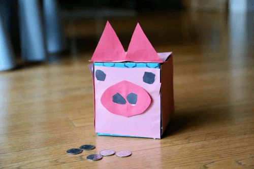 tissue box piggy bank with quarters