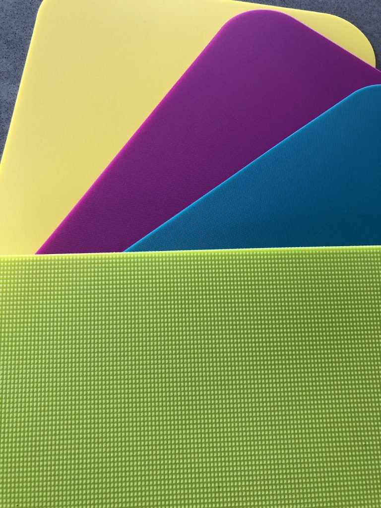 yellow, pink, blue and green Core cutting boards up close