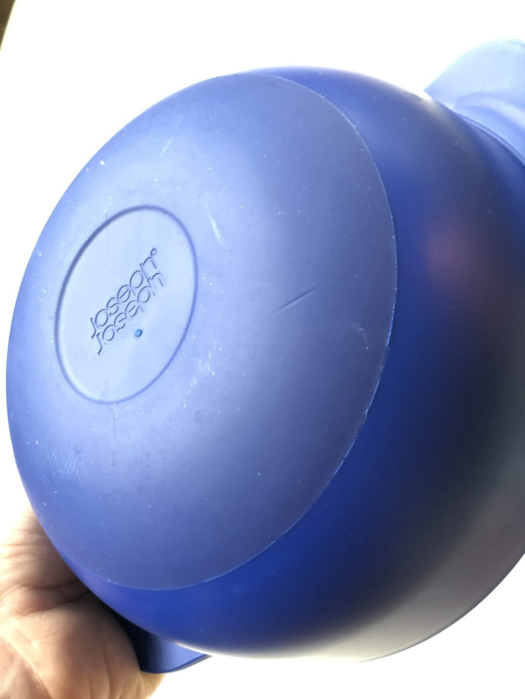 rubber bottom of blue bowl that says Joseph Joseph