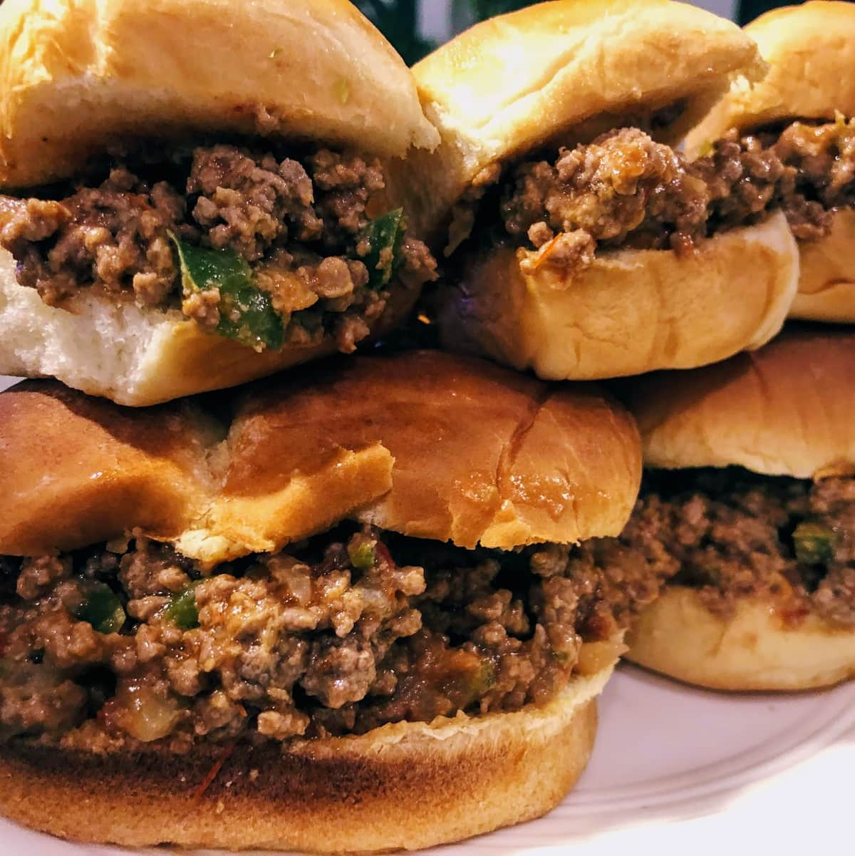 Plate of 6 Sloppy Joe sandwiches, stacked on top of each other