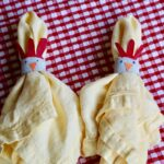 chicken napkin rings holding yellow napkins