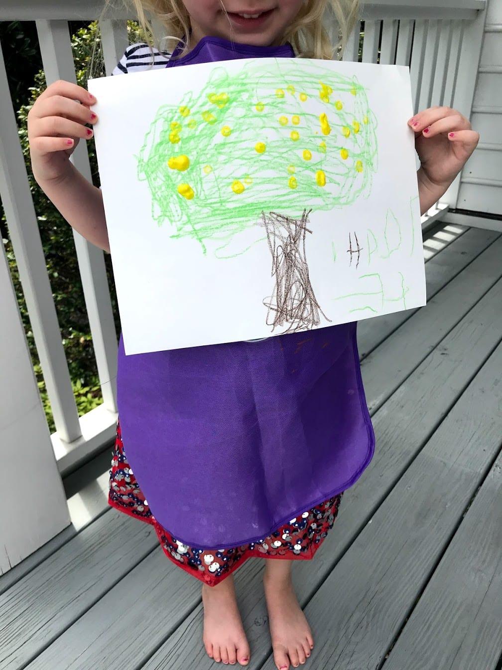 Childs holding Grapefruit tree