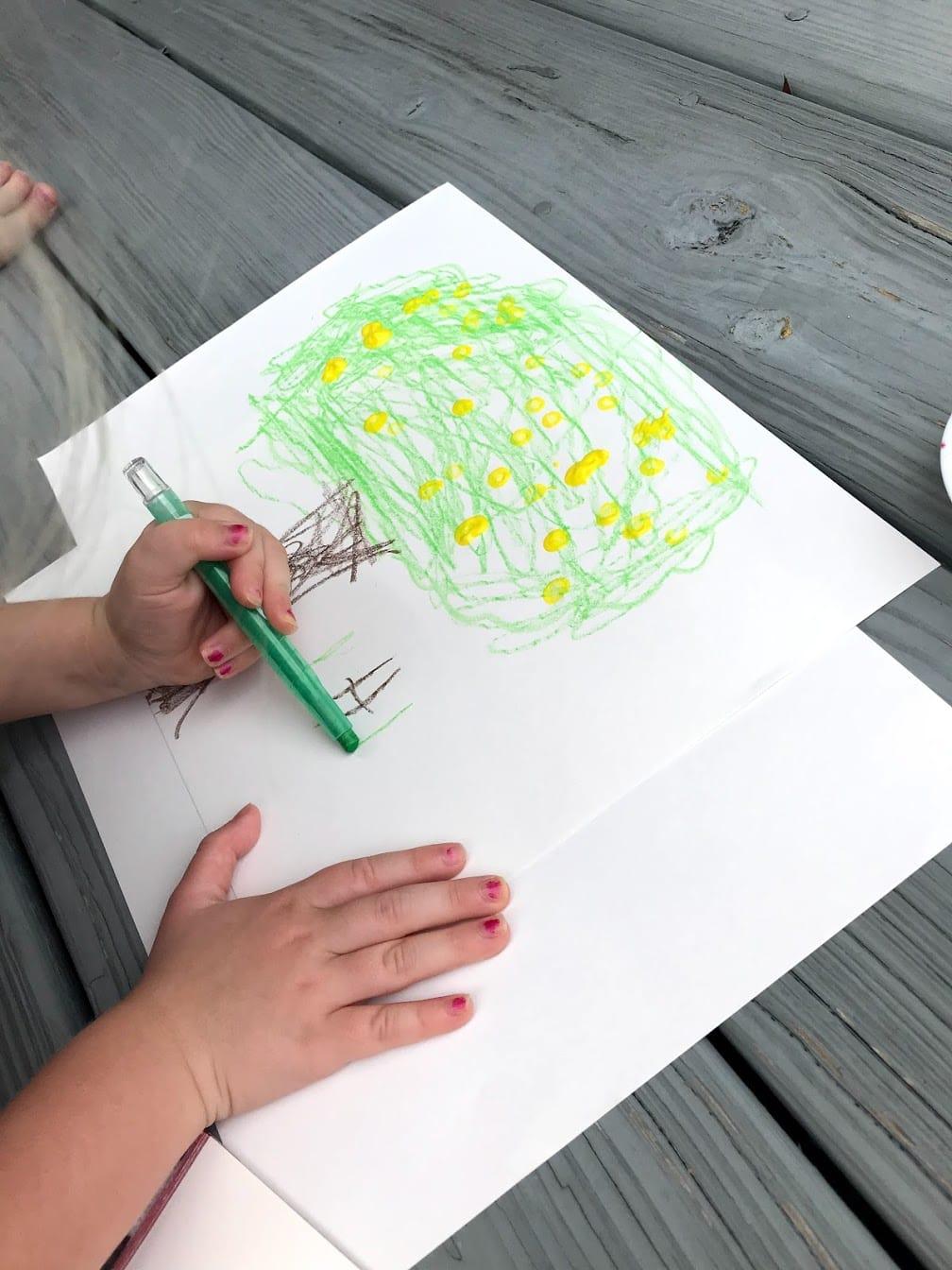 child signing name on artwork