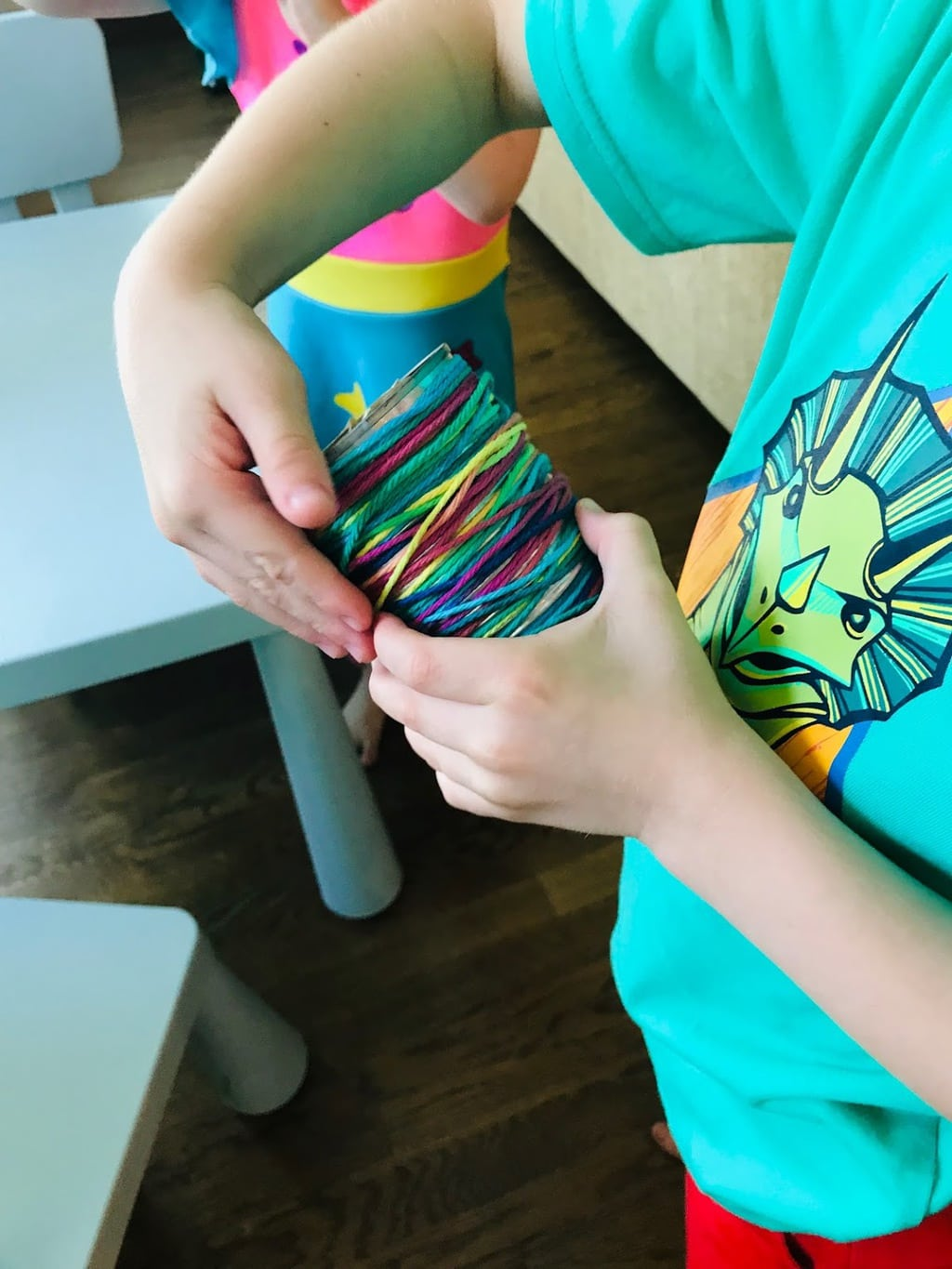 child wrapping string around can