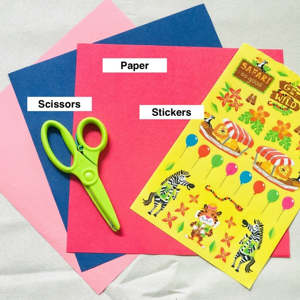 scissors paper and stickers for paper bag craft