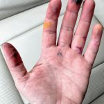 adult hand stained with different color of food dye