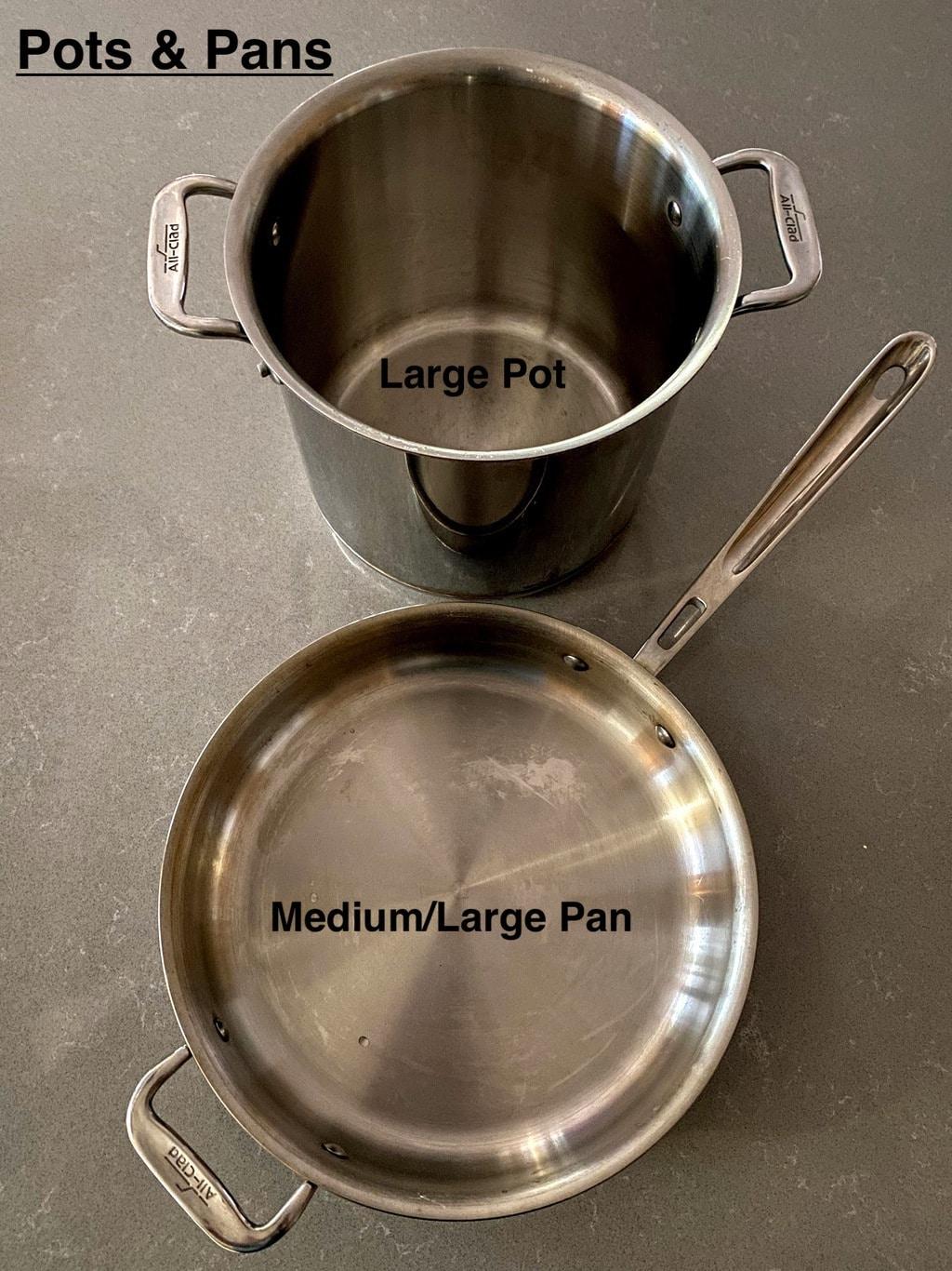 large pot and medium/large pan on grey counter
