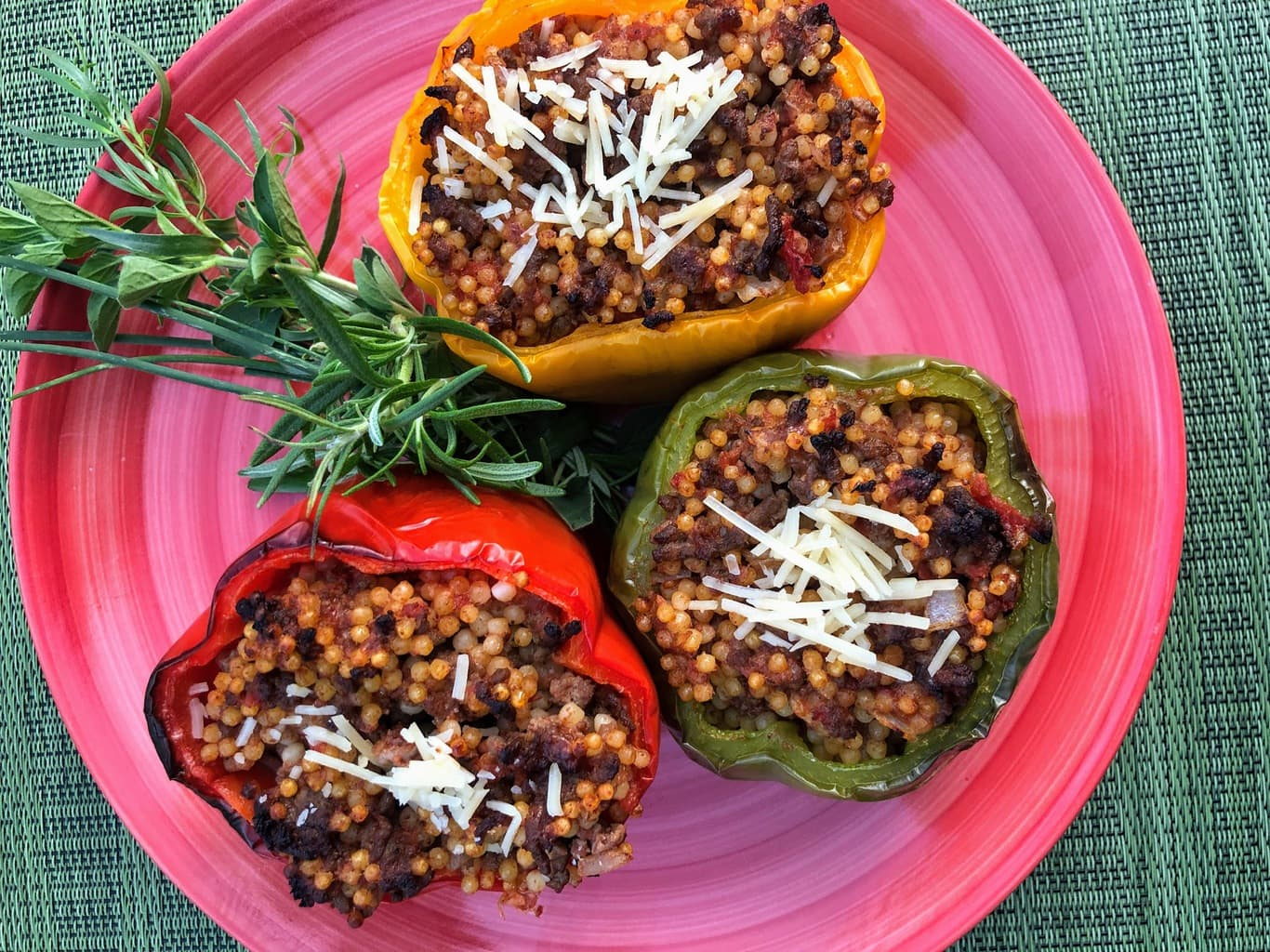 Stuffed Bell Peppers with Beefy, Cheesy Yumminess on pink plate