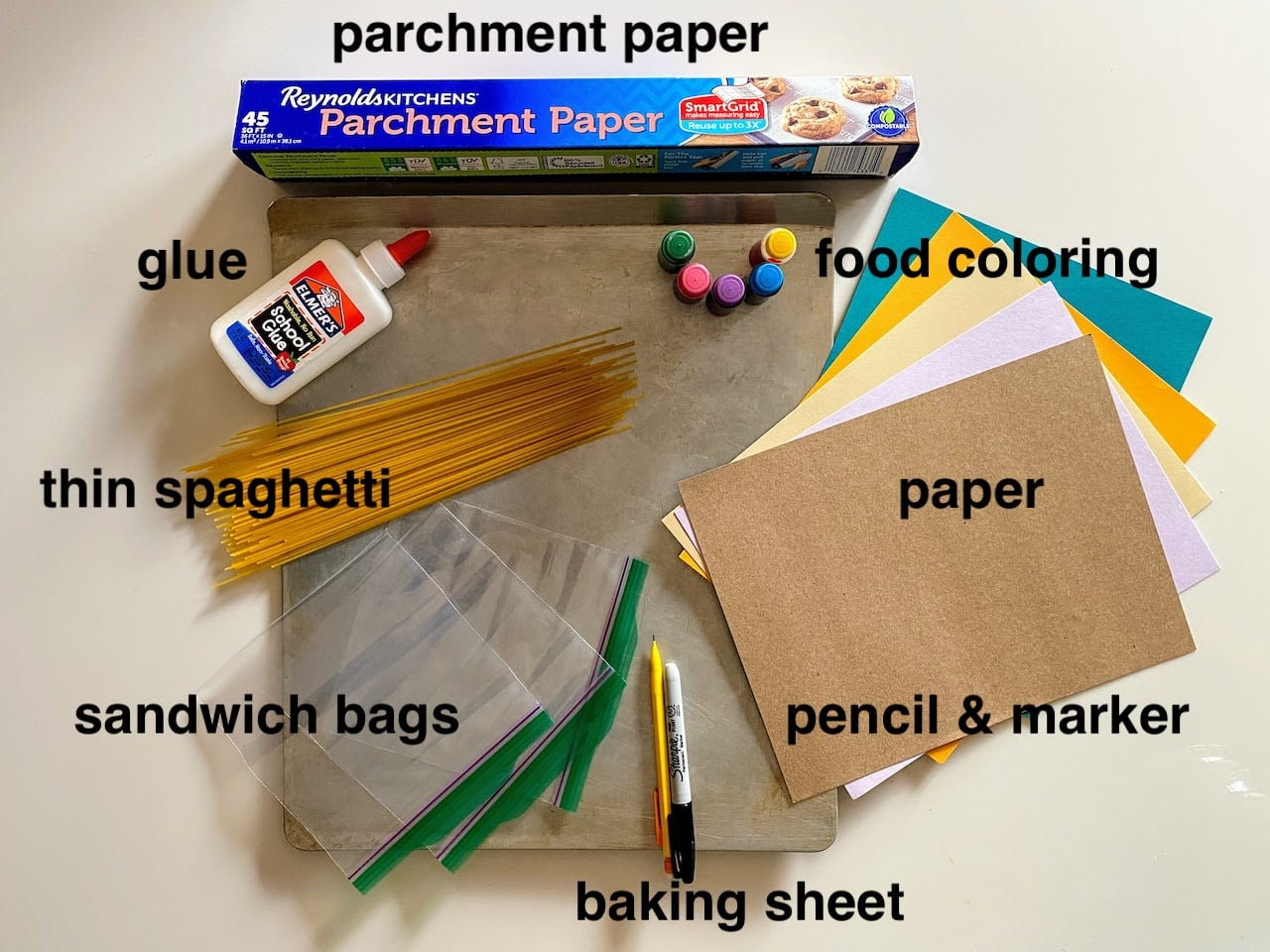 craft supplies for colorful kids art project using dry spaghetti noodles