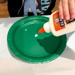 placing glue on green plate