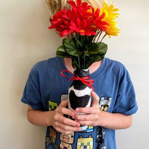 boy holding tissue paper vase