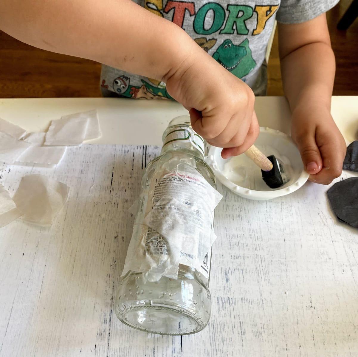 pasting white tissue paper to bottle