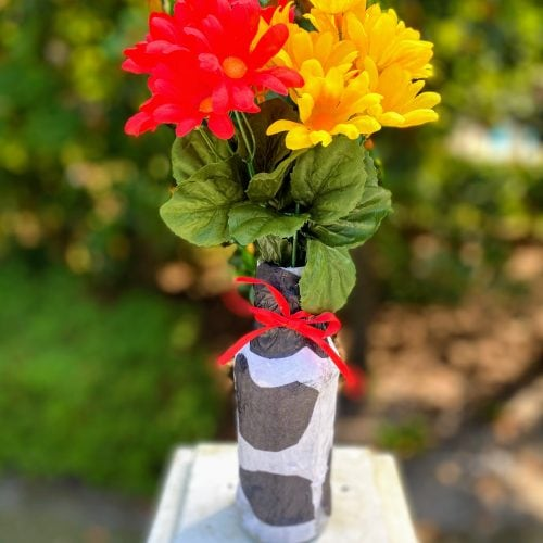 tissue paper vase with red and yellow flowers