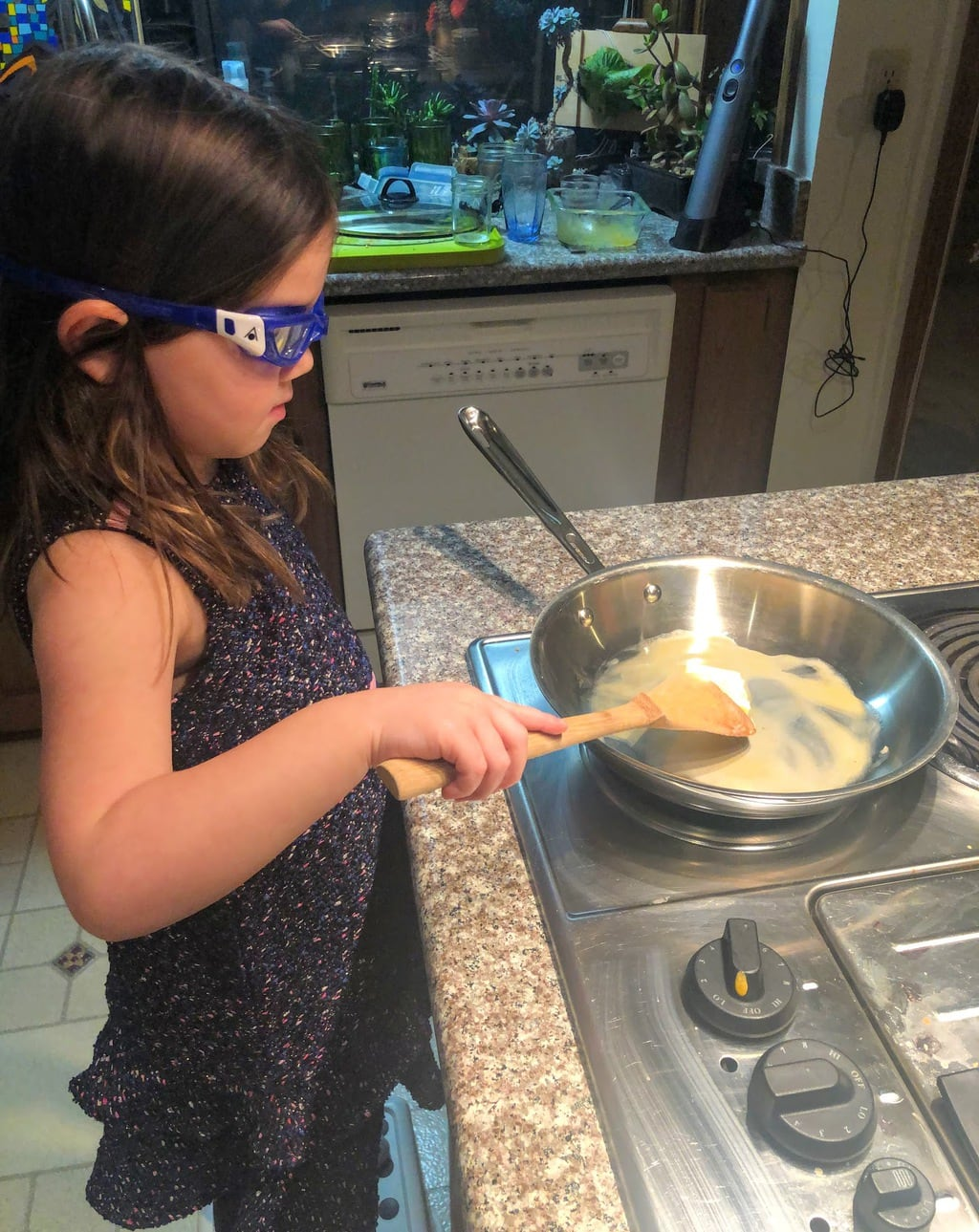 Child Melting butter in pan