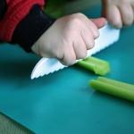 child chopping celery