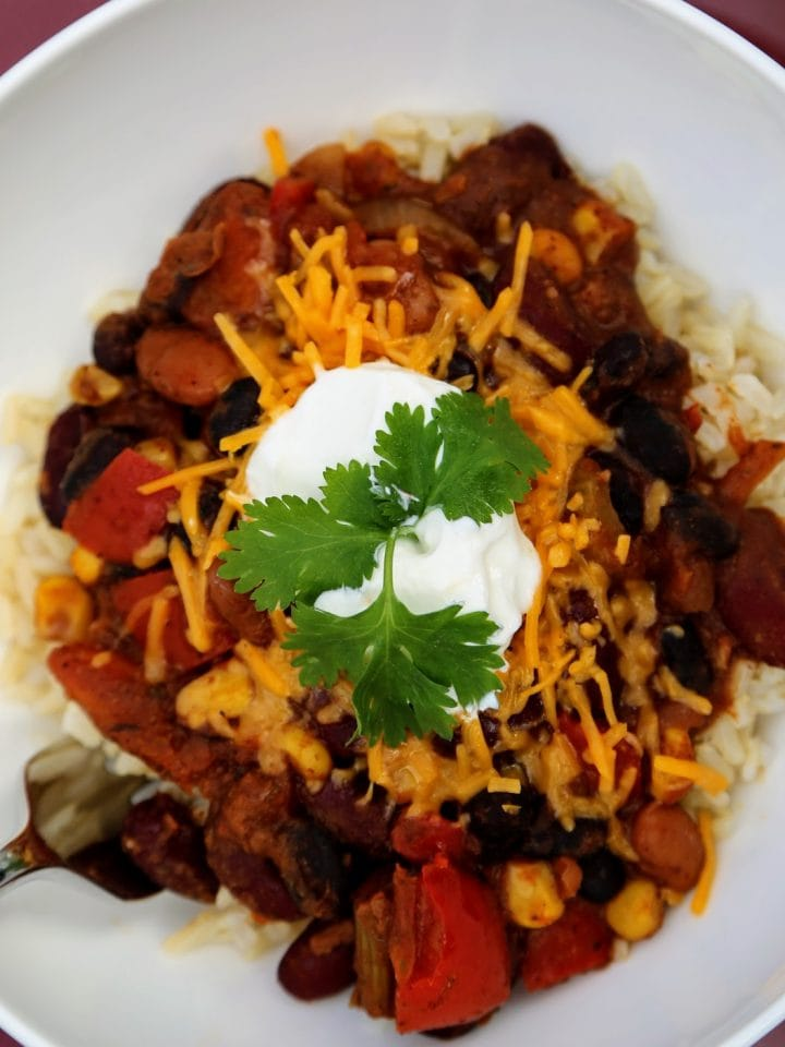 vegetarian chili over rice in bowl