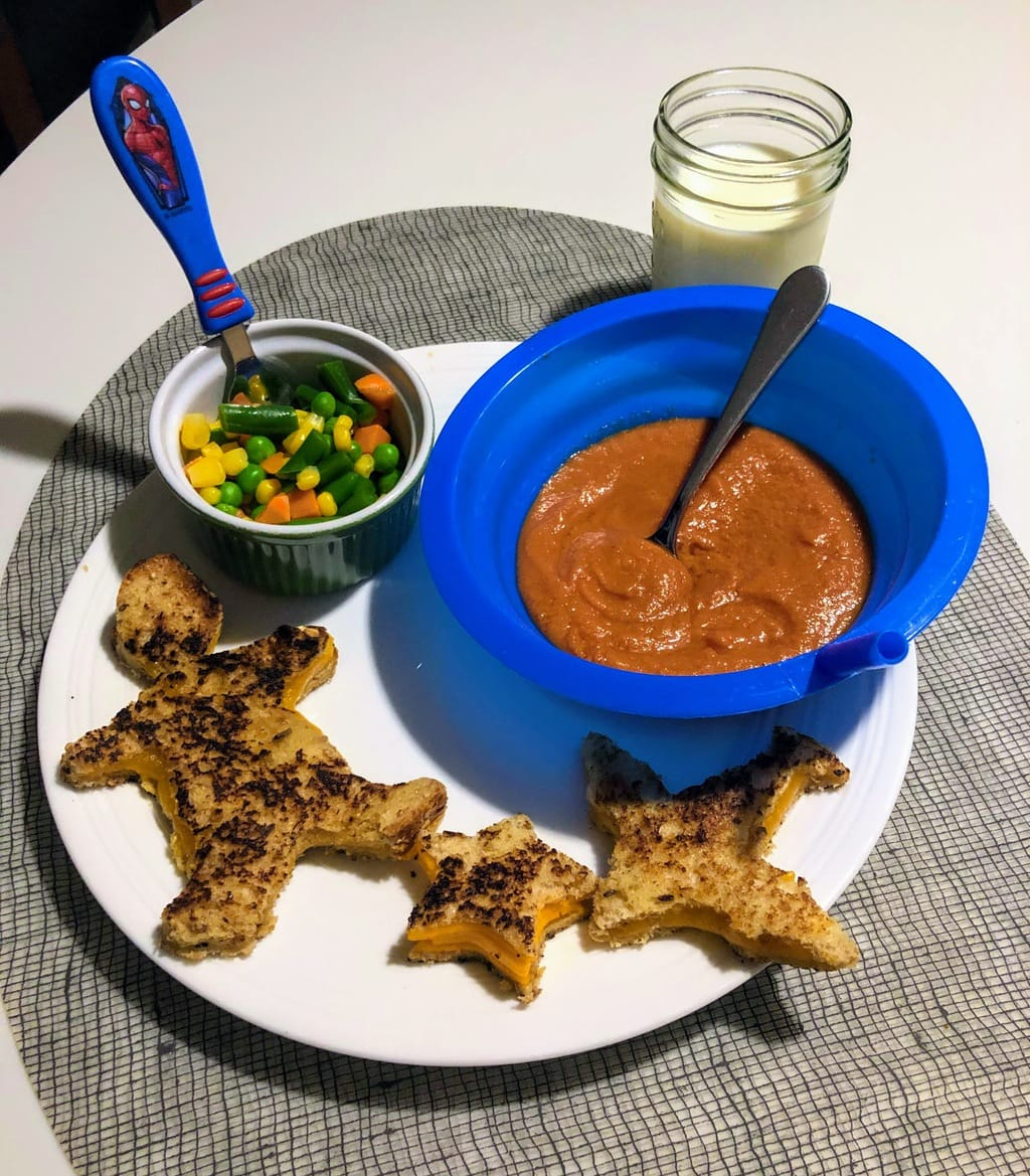 tomato soup, veggies and star and boy shaped grilled cheese