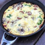cooked frittata with sausage and veggies in pan