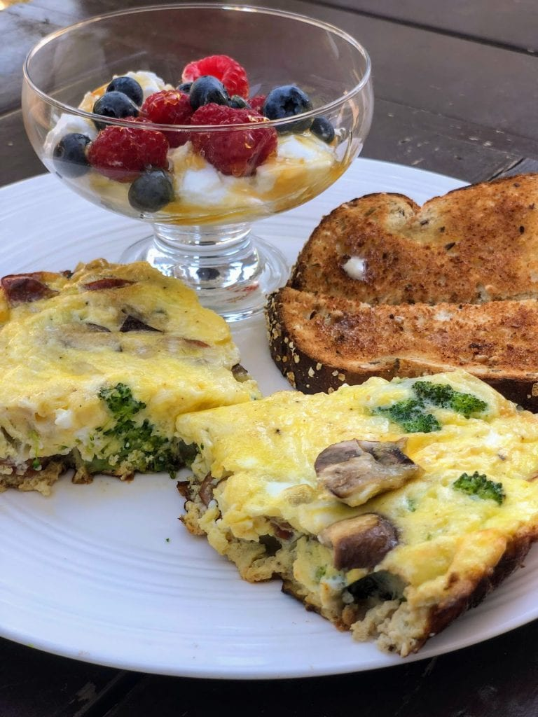 slices of frittata with yogurt and fruit side dish