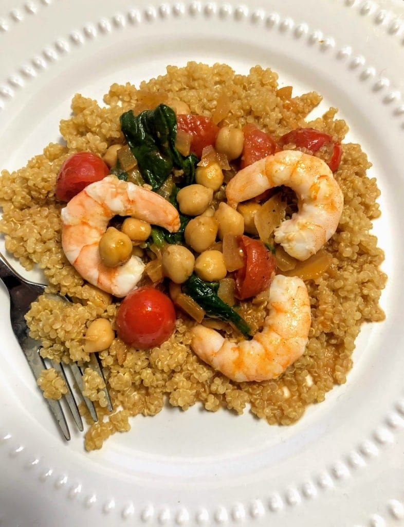 Garlic Shrimp with Chickpeas over Quinoa on plate