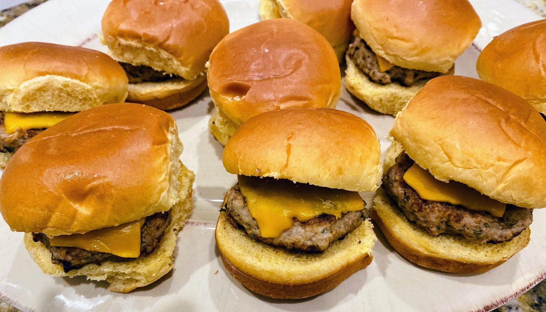 several mini turkey burgers on plate