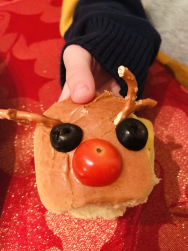 Christmas burger in child's hand