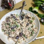 White Bowl of Mixed Chicken Salad, Sitting on Manila Cutting Board