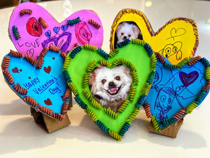 five homemade heart shaped frames with dog photos, valentine's messages and kids drawings