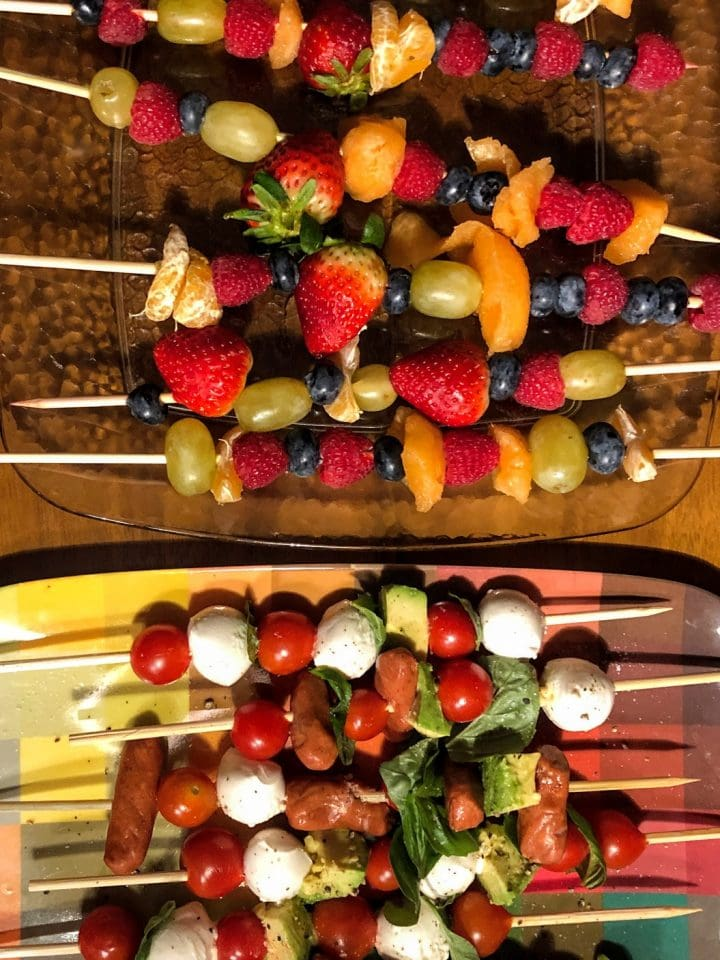collection of fruit and cheese and meat kabobs