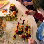 Kids assembling Fruit Kabobs