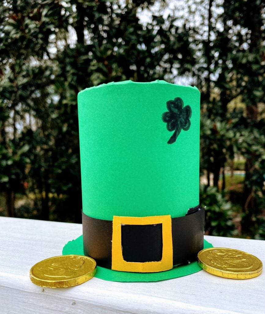 Green Leprechaun hat with coin treasures next to it