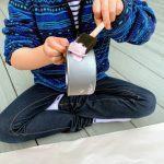 child painting tuna can