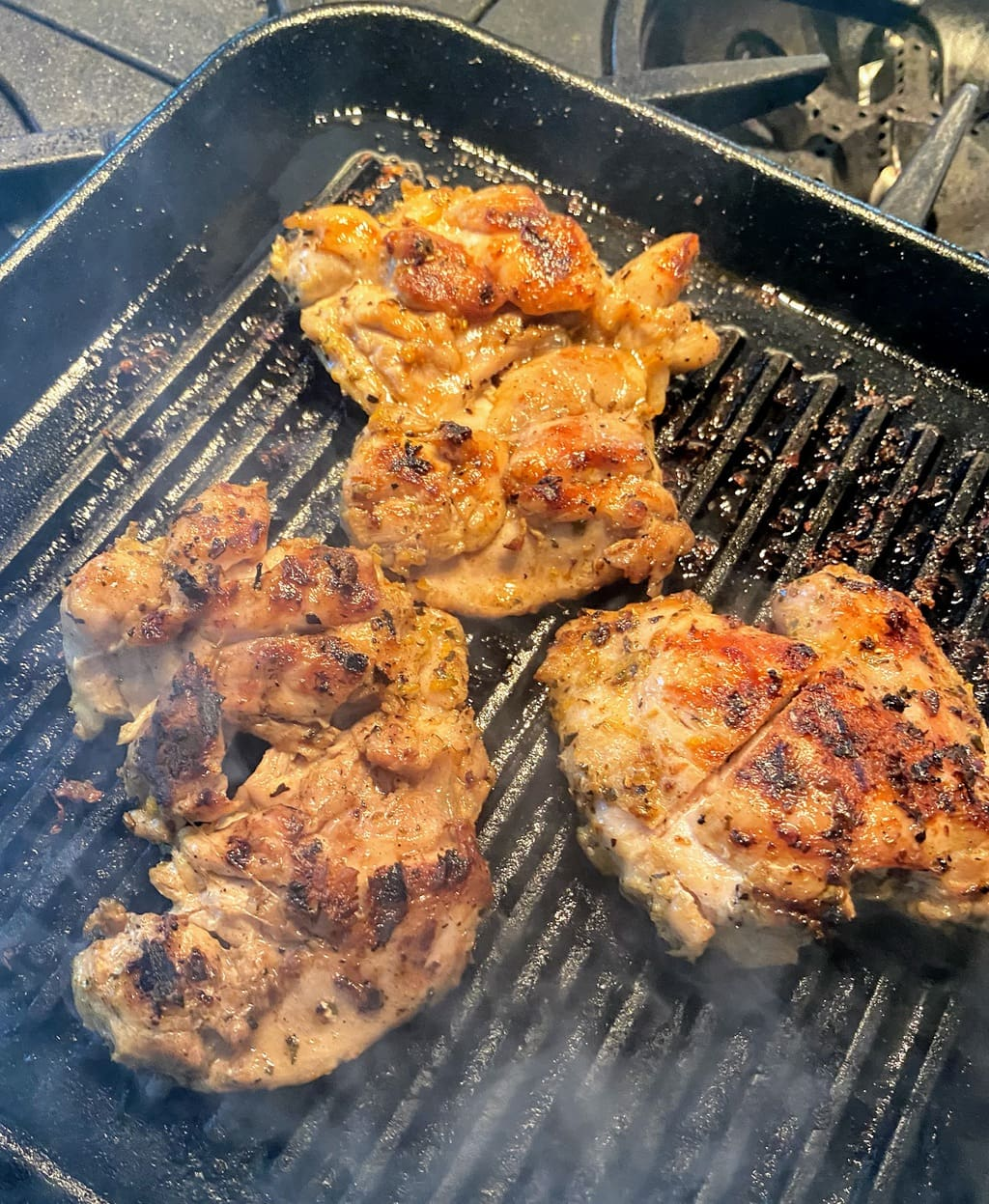 Grill pan with chicken for panzanella salad