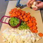 chopped carrots, celery and onion on cutting board