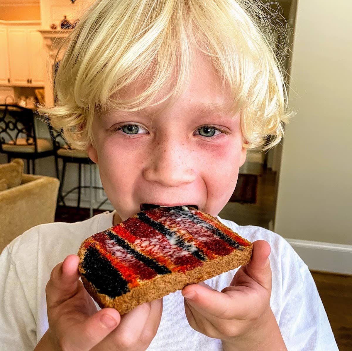 boy eating his painted toast craft