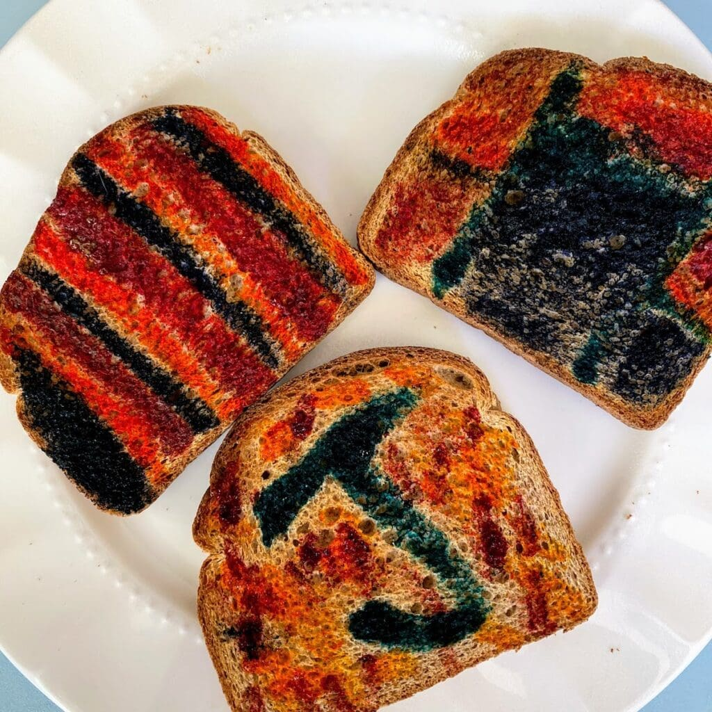 three pieces of painted toast