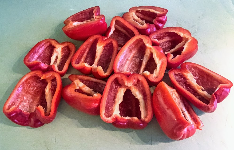 six red bell peppers, cut in half