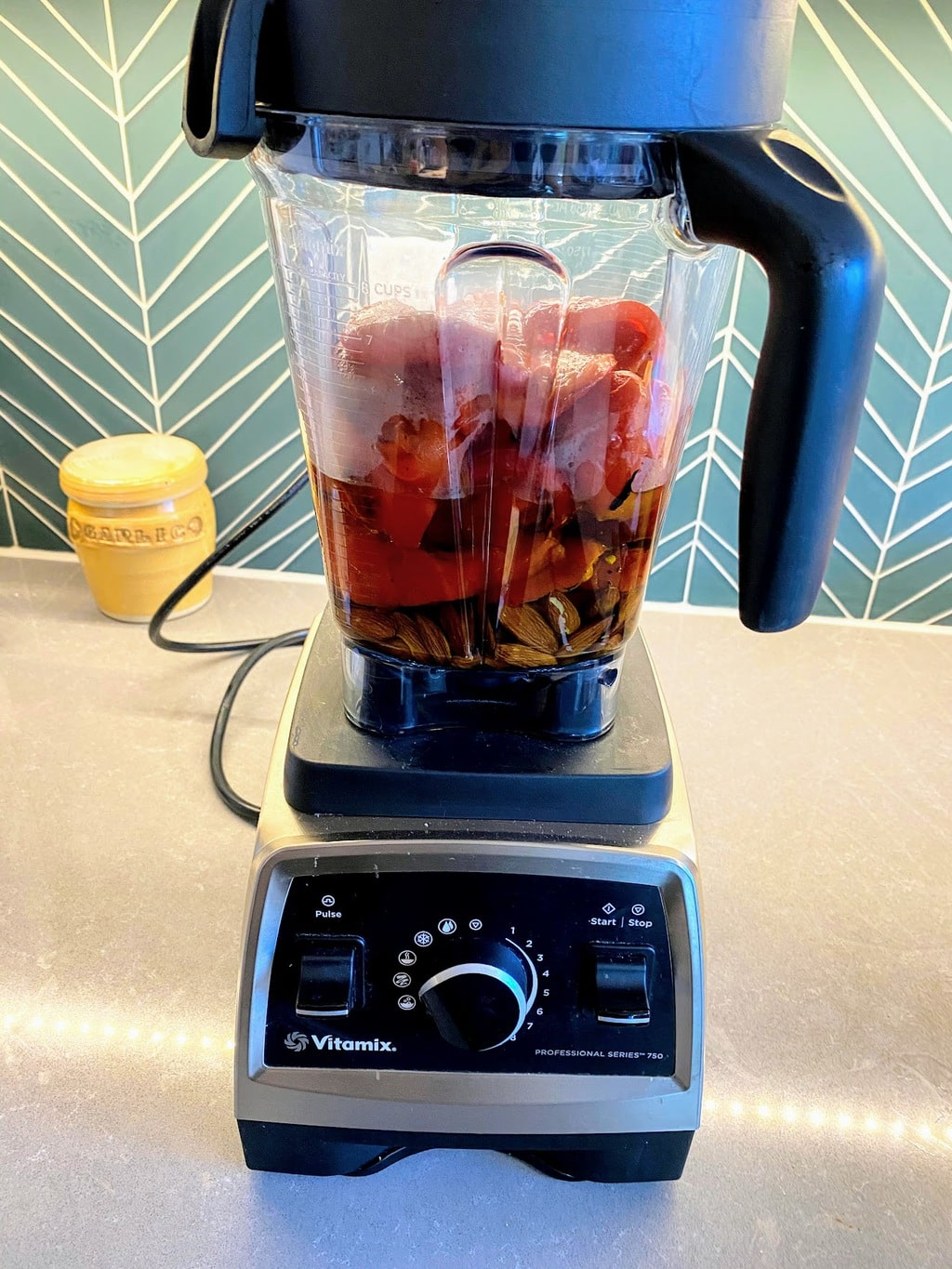 Vitamix filled with romesco ingredients, ready to blend