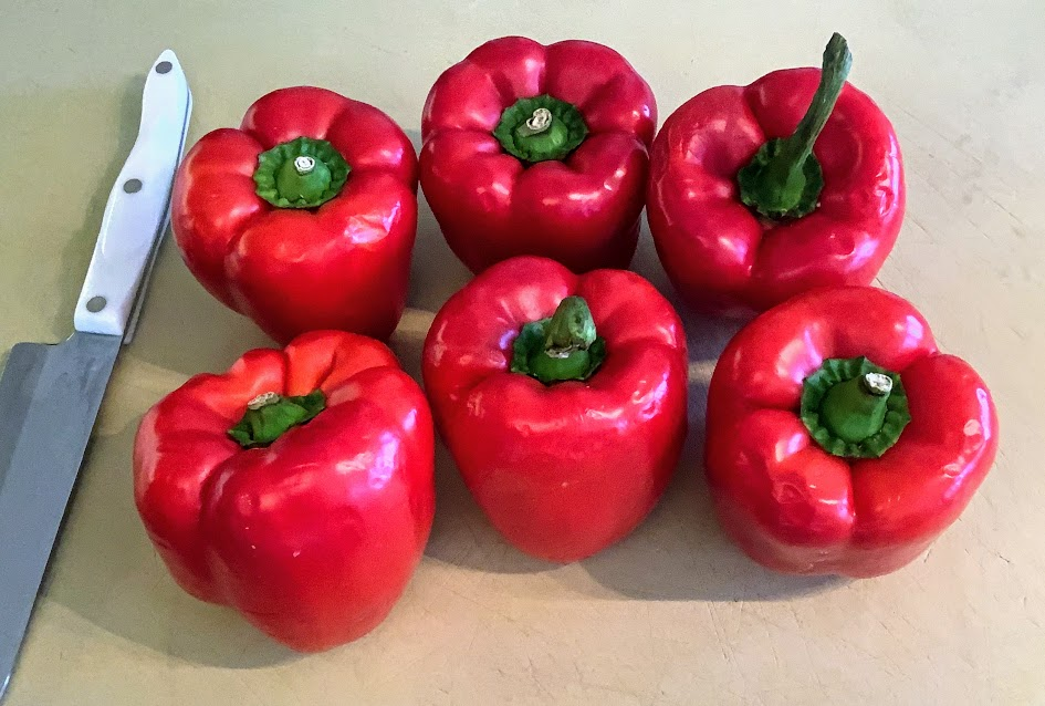 six red bell peppers