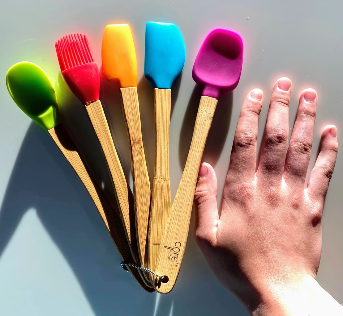 five mini utensils with bamboo handles and different colored heads