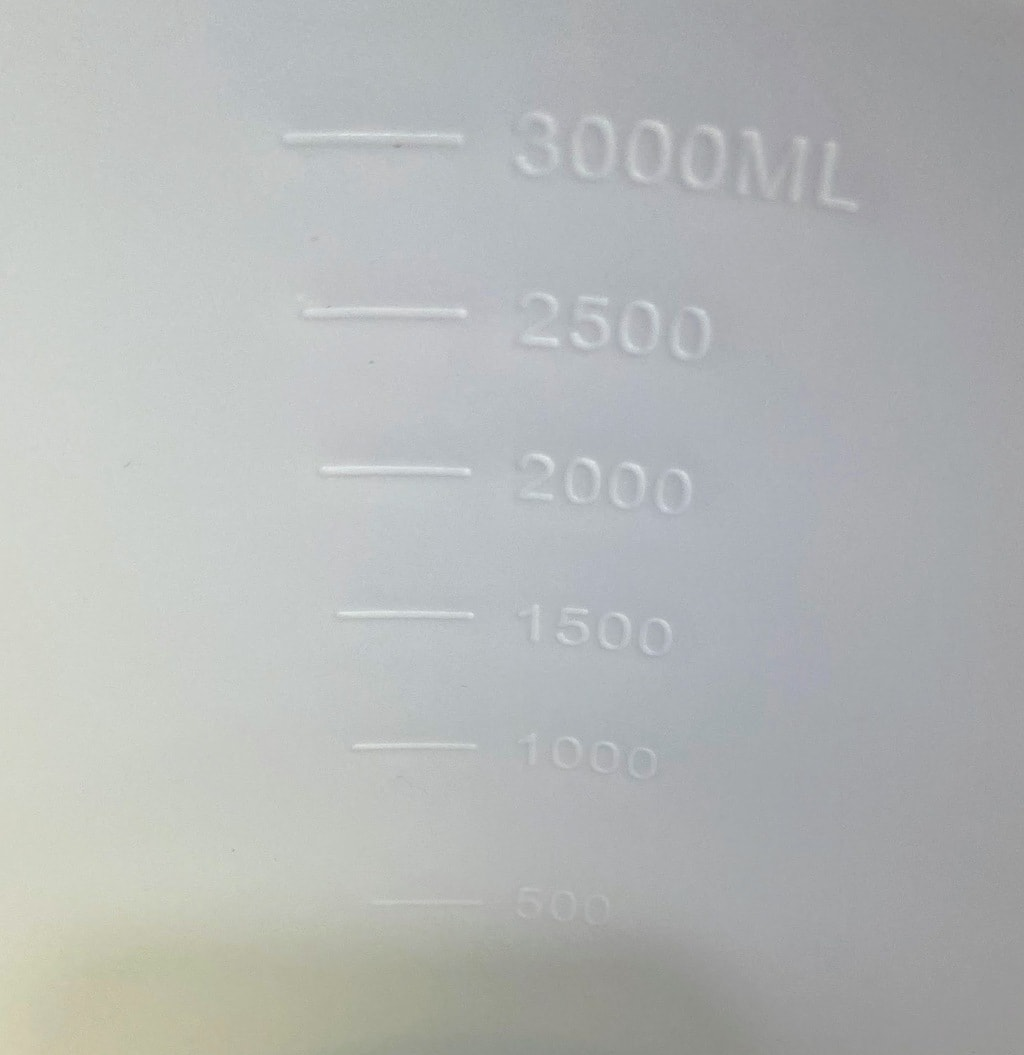 mL markings on inside of a white mixing bowls