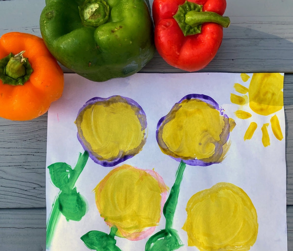 bell pepper stamp art of four yellow flowers