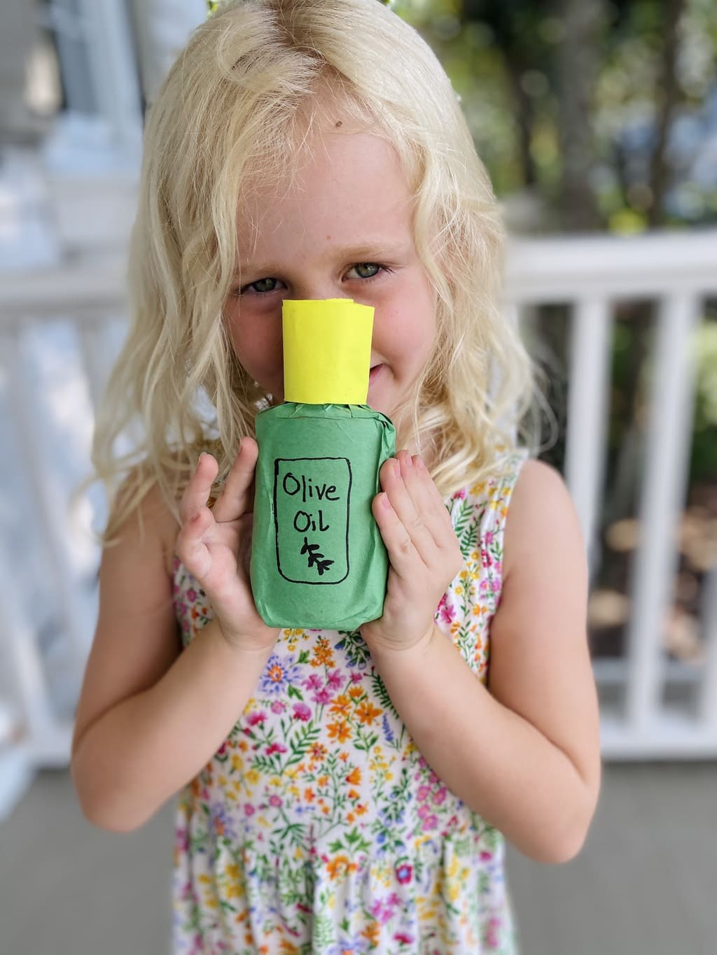 girl holding olive oil bottle craft