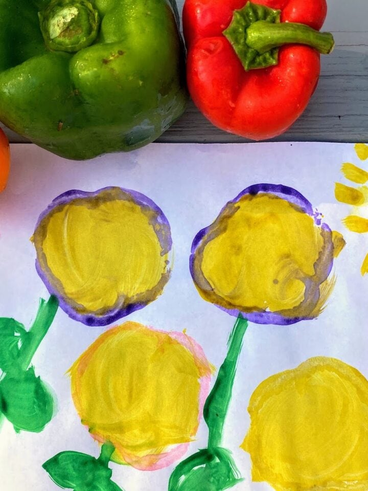 four bell pepper art stamps on white paper
