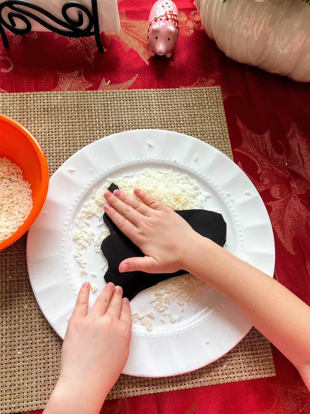 Gluing Rice to Rice Ghost Craft.