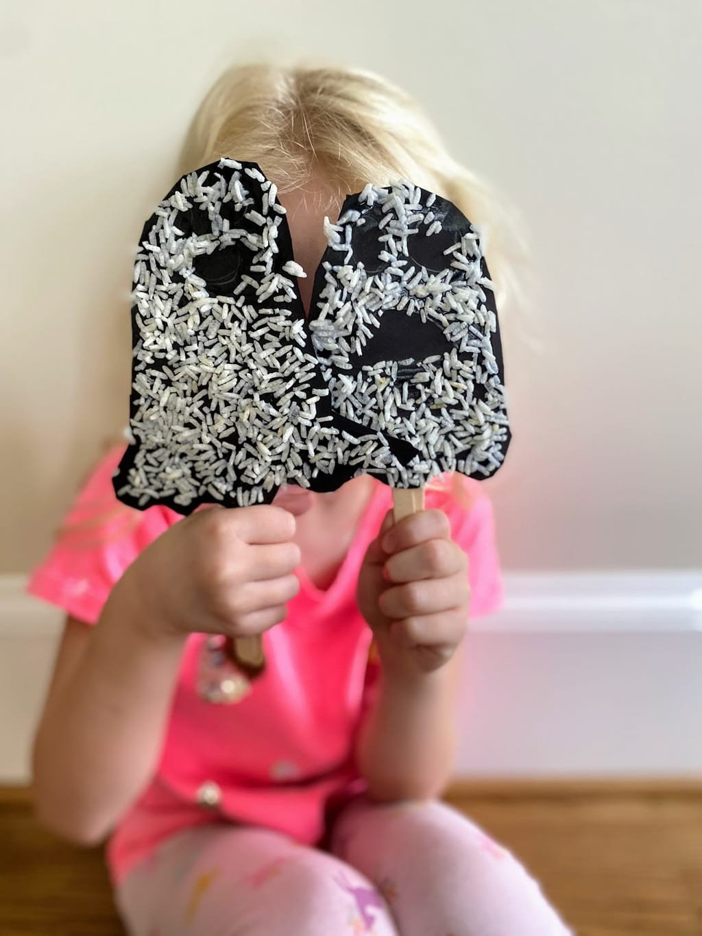 child holding ghost puppets